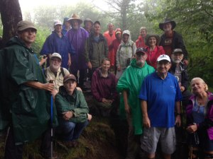 group of hikers in rain en route to Charlies Bunion